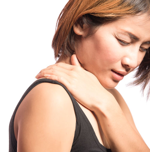Female holding shoulder in pain